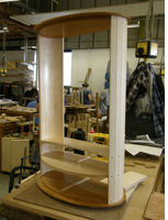 An oval cabinet being made